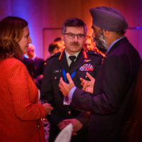 Nancy Southern (Chair, President, and CEO of ATCO ltd.), Lt. Gen. Paul Wynnyk (Commander of the Army, Canadian Armed Forces), and Minister Harjit Singh Sajjan (Minister of National Defence, Canada).