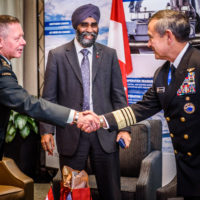 General Jonathan Vance (Chief of the Defense Staff General, Canada) greets Admiral Harry Harris (Commander, US Pacific Command)