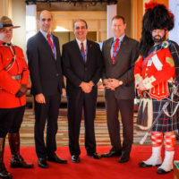 Minister Steven Blaney (Minister of Public Safety, Canada), Peter Van Praagh (President, Halifax International Security Forum), and Minister Peter MacKay (Minister of Justice and Attorney General, Canada) with members of the Royal Canadian Mounted Police