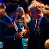 Minister Harjit Sajjan (Minister of National Defence of Canada) speaks with Robert O'Brien (US National Security Advisor).