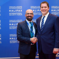 Peter Van Praagh (President of Halifax International Security Forum) shakes hands with Andrew Scheer (Leader of the Conservative Party of Canada).