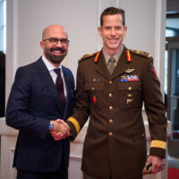 Peter Van Praagh (President of Halifax International Security Forum) shakes hands with General Peter Dawe (Commander, Canadian Special Operations Forces Command).