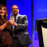 Peter Van Praagh (President of Halifax International Security Forum) presents the 2019 Builder Award to Nancy Southern (Chair and Chief Executive Officer, ATCO).