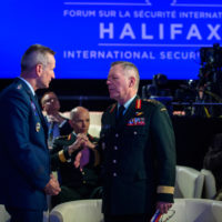General Terrence J. O'Shaughnessy, (Commander of North American Aerospace Defense Command and United States Northern Command) speaks with General Jonathan Vance (Chief of the Defence Staff, Canadian Armed Forces).